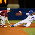 University of Florida Gators catcher/first baseman JJ Schwarz slides into second base but is tagged out as the #2 ranked Gators defeat the #7 Florida State Seminoles 12-6 at McKethan Stadium.  February 16th, 2017. Gator Country photo by David Bowie.