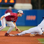 University of Florida Gators outfielder/pitcher Nick Horvath slides into second base but is tagged out as the #2 ranked Gators defeat the #7 Florida State Seminoles 12-6 at McKethan Stadium.  February 16th, 2017. Gator Country photo by David Bowie.