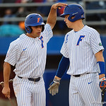 University of Florida Gators outfielder/pitcher Nick Horvath and University of Florida Gators catcher/first baseman JJ Schwarz celebrate after Horvath scored as the #2 ranked Gators defeat the #7 Florida State Seminoles 12-6 at McKethan Stadium.  February 16th, 2017. Gator Country photo by David Bowie.