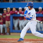 University of Florida Gators outfielder/pitcher Austin Langworthy singles as the #2 ranked Gators defeat the #7 Florida State Seminoles 12-6 at McKethan Stadium.  February 16th, 2017. Gator Country photo by David Bowie.