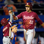 FSU infielder DREW MENDOZA gets a high five from the bat boy after hitting a home run as the #2 ranked Gators defeat the #7 Florida State Seminoles 12-6 at McKethan Stadium.  February 16th, 2017. Gator Country photo by David Bowie.