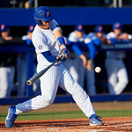 University of Florida Gators catcher/first baseman JJ Schwarz swings away at a pitch as the #2 ranked Gators defeat the #7 Florida State Seminoles 12-6 at McKethan Stadium.  February 16th, 2017. Gator Country photo by David Bowie.