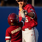 Florida State catcher Cal Raleigh gets a high five from the FSU batboy after hitting a home run in the first inning as the #2 ranked Gators defeat the #7 Florida State Seminoles 12-6 at McKethan Stadium.  February 16th, 2017. Gator Country photo by David Bowie.
