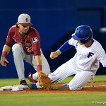 University of Florida Gators catcher/first baseman JJ Schwarz slides into third base but is tagged out as the #2 ranked Gators defeat the #7 Florida State Seminoles 12-6 at McKethan Stadium.  February 16th, 2017. Gator Country photo by David Bowie.