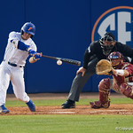 University of Florida Gators infielder Deacon Liput singles as the #2 ranked Gators defeat the #7 Florida State Seminoles 12-6 at McKethan Stadium.  February 16th, 2017. Gator Country photo by David Bowie.