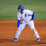 University of Florida Gators outfielder/pitcher Austin Langworthy leads off first base as the #2 ranked Gators defeat the #7 Florida State Seminoles 12-6 at McKethan Stadium.  February 16th, 2017. Gator Country photo by David Bowie.