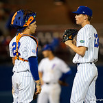 University of Florida Gators catcher/first baseman JJ Schwarz comes out to the pitching mound to talk with University of Florida Gators pitcher Jack Leftwich as the #2 ranked Gators defeat the #7 Florida State Seminoles 12-6 at McKethan Stadium.  February 16th, 2017. Gator Country photo by David Bowie.