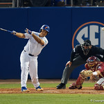 University of Florida Gators outfielder/pitcher Keenan Bell doubles to drive in two runs as the #2 ranked Gators defeat the #7 Florida State Seminoles 12-6 at McKethan Stadium.  February 16th, 2017. Gator Country photo by David Bowie.