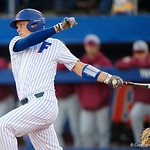 University of Florida Gators catcher/first baseman JJ Schwarz swinging away as the #2 ranked Gators defeat the #7 Florida State Seminoles 12-6 at McKethan Stadium.  February 16th, 2017. Gator Country photo by David Bowie.