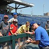 University of Florida catcher Jonah Girand signs an autograph during the Florida Gators first practice at TD Ameritrade park for the 2018 College World Series.
