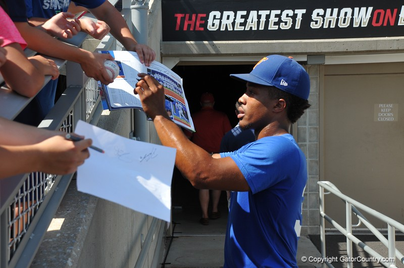 University of Florida pitcher Andrew Baker signs an autograph after the Florida Gators first practice at TD Ameritrade park for the 2018 College World Series.