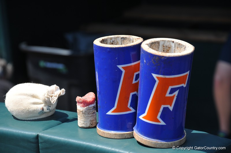 A rosin bag, Tiger Stick and batting weights lined up for the Florida Gators at the 2018 College World Series.