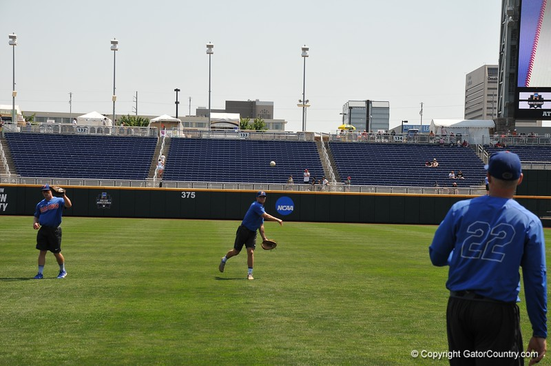 University of Florida catchers JJ Schwarz and Cal greenfield warming up during the Florida Gators first practice at TD Ameritrade park for the 2018 College World Series.