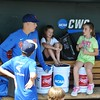 University of Florida senior JJ Schwarz talks with Payton O'Sullivan in the dugout during the Florida Gators first practice at TD Ameritrade park for the 2018 College World Series.
