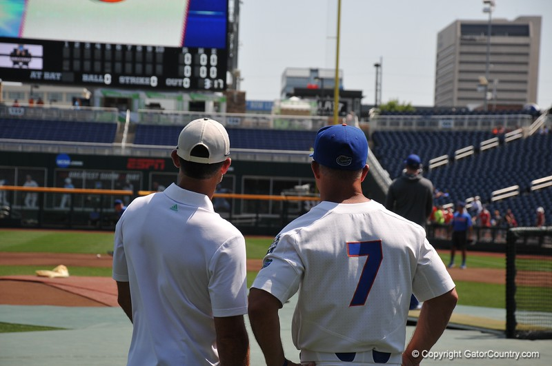 University of Florida manager Kevin O'Sullivan and ESPN host Chris Vurke talk during the Florida Gators first practice at TD Ameritrade park for the 2018 College World Series.