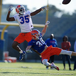 University of Florida Gators defensive back Trey Dean III breaks up a pass to University of Florida Gators defensive back Anthony Giglia as the Gators run drills during the first day 2018 spring practices at Sanders Field at the Universitu of Florida.  March 16th, 2018.  Gator Country photo by David Bowie.