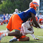 University of Florida Gators defensive back CJ Henderson makes an interception and is ht by University of Florida Gators tight end C'yontai Lewis as the Gators run drills during the first day 2018 spring practices at Sanders Field at the Universitu of Florida.  March 16th, 2018.  Gator Country photo by David Bowie.