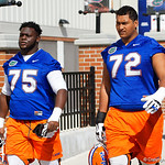University of Florida Gators offensive lineman T.J. Moore and University of Florida Gators offensive lineman Stone Forsythe walk into practice as the Gators run drills during the first day 2018 spring practices at Sanders Field at the Universitu of Florida.  March 16th, 2018.  Gator Country photo by David Bowie.