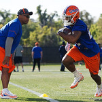 University of Florida Gators running backs coach Greg Knox working with University of Florida Gators running back Lamical Perine as the Gators run drills during the first day 2018 spring practices at Sanders Field at the Universitu of Florida.  March 16th, 2018.  Gator Country photo by David Bowie.