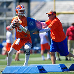 University of Florida Gators quarterback Feleipe Franks throwing as University of Florida Gators Head Coach Dan Mullen tries to distract him as the Gators run drills during the second day of 2018 spring practices at Sanders Field at the University of Florida.  March 17th, 2018.  Gator Country photo by David Bowie.
