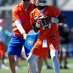 University of Florida Gators quarterback Emory Jones as University of Florida Gators Head Coach Dan Mullen tries to distract him while throwing as the Gators run drills during the second day of 2018 spring practices at Sanders Field at the University of Florida.  March 17th, 2018.  Gator Country photo by David Bowie.