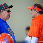 University of Florida Gators Defensive Line coach Sal Sunseri talking with University of Florida Gators Head Coach Dan Mullen as the Gators run drills during the second day of 2018 spring practices at Sanders Field at the University of Florida.  March 17th, 2018.  Gator Country photo by David Bowie.
