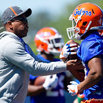 University of Florida Gators running backs coach Greg Knox working with the running backs as the Gators run drills during the second day of 2018 spring practices at Sanders Field at the University of Florida.  March 17th, 2018.  Gator Country photo by David Bowie.