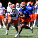 University of Florida Gators running back Lamical Perine rushing as the Gators run drills during the second day of 2018 spring practices at Sanders Field at the University of Florida.  March 17th, 2018.  Gator Country photo by David Bowie.