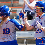 University of Florida Gators Softball infielder Nicole DeWitt and University of Florida Gators Softball outifelder Amanda Lorenz high five as the Gators go up 3-0 in the first inning, as the Gators defeat the Maryland Terrapins 12-0 at Katie Seashole Pressly Softball Stadium in Gainesville, Florida.  February 24th, 2018. Gator Country photo by David Bowie.