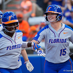 University of Florida Gators Softball UT/C Danielle Romanello smiling after scoring as the Gators defeat the Maryland Terrapins 12-0 at Katie Seashole Pressly Softball Stadium in Gainesville, Florida.  February 24th, 2018. Gator Country photo by David Bowie.