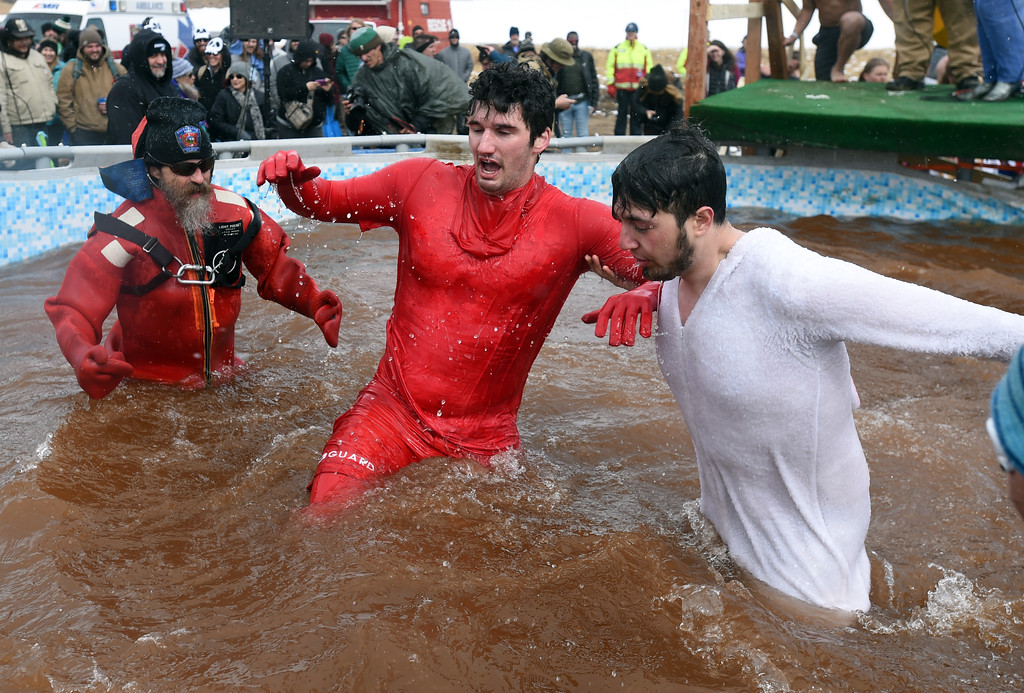 . Ben Chappell, center, managed to make it to the plunge after an ankle injury  on Saturday during 2018 Frozen Dead Guy Days in Nederland. The festival continues on Sunday. For more photos, go to dailycamera.com. Cliff Grassmick  Photographer  March 10, 2018