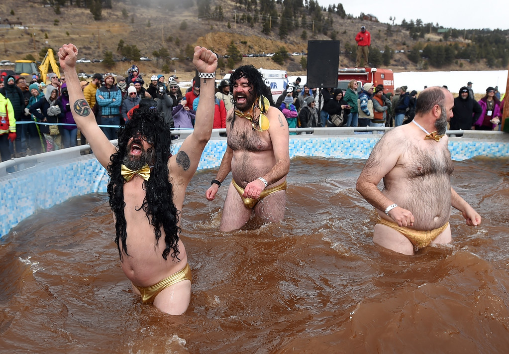 . Danny Duke, left, Ryan Poe, and Bryan Kritz, celebrate their plunge success  on Saturday during 2018 Frozen Dead Guy Days in Nederland. The festival continues on Sunday. For more photos, go to dailycamera.com. Cliff Grassmick  Photographer  March 10, 2018