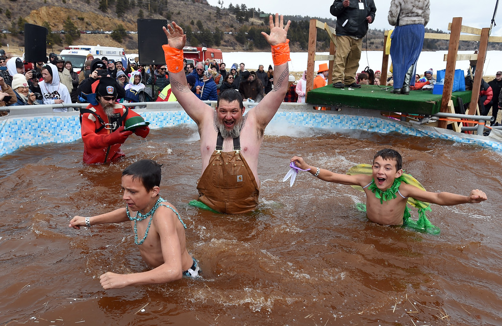 . Father and sons team up for a cold splash on Saturday during 2018 Frozen Dead Guy Days in Nederland. The festival continues on Sunday. For more photos, go to dailycamera.com. Cliff Grassmick  Photographer  March 10, 2018