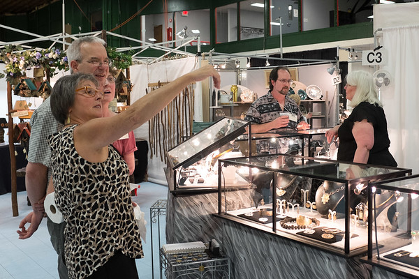 JOED VIERA/STAFF PHOTOGRAPHER-Lockport, NY-Patrons check out crafts at the Kenan Center during their 100 Craftsman event.