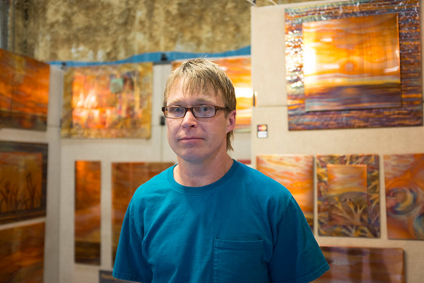 """JOED VIERA/STAFF PHOTOGRAPHER-Lockport, NY-Rob Yates stands in front of his copper fire paintings. Yates, a Binghampton native has been working with copper for the past 22 years and has been a Kenan Craftsman participant for the past 3 years.""""Different tempuratures produce different colors, the process evolved from my other copper work."""""""