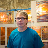 "JOED VIERA/STAFF PHOTOGRAPHER-Lockport, NY-Rob Yates stands in front of his copper fire paintings. Yates, a Binghampton native has been working with copper for the past 22 years and has been a Kenan Craftsman participant for the past 3 years.""Different tempuratures produce different colors, the process evolved from my other copper work."""