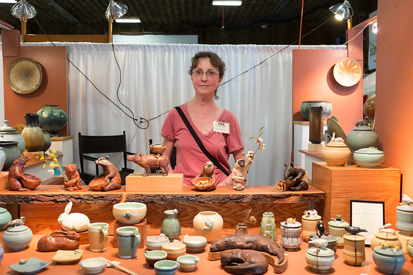 JOED VIERA/STAFF PHOTOGRAPHER-Lockport, NY-Carolyn Dilcher-Stutz stands at her booth at the Kenan Center during their 100 Craftsman event. Carolyn has been working ceramics into animals for 8 years and has been a Kenan craftsman participant for the past 5. She made a life change after working at an animal hospital and enjoys crafting ceramics into endagered animals and using her art to explain wildlife.