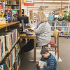 James Neiss/staff photographer <br /> Sanborn, NY - Lynne Conrad of Lewiston works on the computer at the Sanborn Public Library as her son Drew, 8, enjoys a good read.