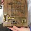 Roger Schneider | The Goshen News<br /> Carl Weaver holds his Good of Goshen award he received at the Goshen Founders Day luncheon Thursday.