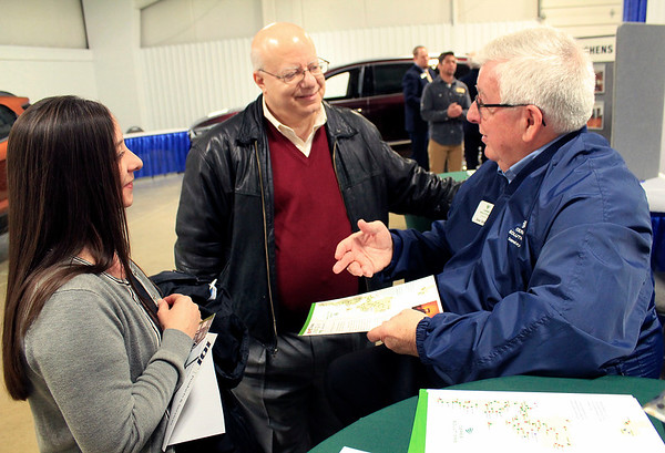 Roger Schneider | The Goshen News<br /> <br /> Tina Fraley and David Tone, from left, of the Council on Aging, talk with Dean DeVoe at the Ceres Solutions booth at the Goshen Founder's Day event Thursday.