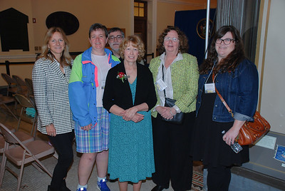 Group shot of Debbie Daggett, Volunteer Coordinator at Freeport Community Services, and others from the organization