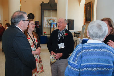 Howard Bliss, Volunteer of the Year, speaks with John Portela, MCCS Chair, and Laurel Bernier, Grants Officer with MCCS