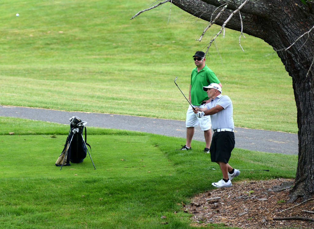 . Tania Barricklo-Daily Freeman    Johnny Garcia  with J.D. Hartwell as caddy.