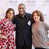 (Left to Right) Crittenton Board Members Kymber Lovett-Menkiti and Aaron Myers, with Champion, Stephanie Saturni
