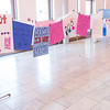 The Artivism Gallery of Teen Posters hangs in the event atrium for guests to view.
