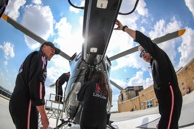 IU Health ride along with the LifeLine Lafayette, IN airbase on June 12, 2017. Following LifeLine staff: Pilot Werner Winkler, Flight Nurse Venessa Scott, and Flight Paramedic Todd Hope. During the day shadow from 7am-7pm a critical care transport from Elkhart to Methodist Hospital was conducted using the mobile Balloon Pump on board the helicopter. Photographed: (Left) Richmond based flight paramedic Jamie Swboda, (Middle) flight nurse Venessa Scott, (Right) flight paramedic Todd Hope wait at Methodist Hospital during a routine aircraft swap for maintenance. (IU Health/Evan De Stefano)