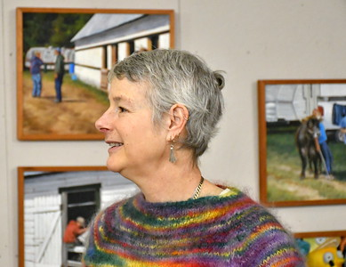 DSC_0416 newell in front of paintings from tunbridge fair