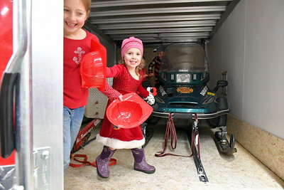 RSR_4787 Baiah,8, and Aoife,4, Edmunds,,chase each other in and out of of the Off Road Rescue Trailer