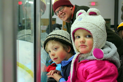IMG_0220 erik kostelnik of San Jose CA, with kids Mason,,6, and Tessa, 2,,watching the zamboni