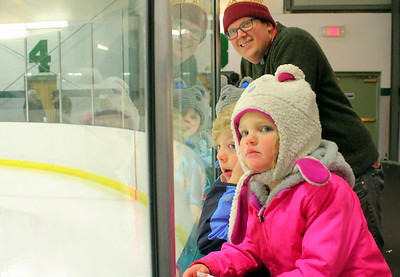 IMG_0238 erik kostelnik of San Jose CA with his kids, Tessa,2, mason, 6, and sawyer,2, watching zamboni